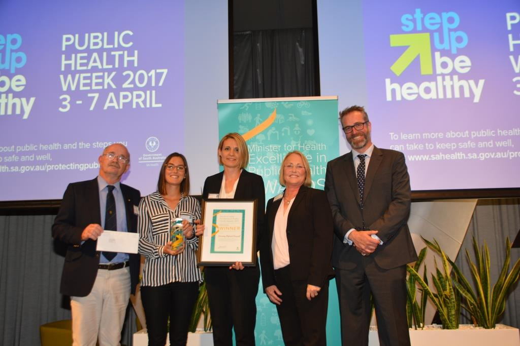 From left: Mayor Jaensch with Council OPAL staff Emily Arbon and Tanja Morgan accepting their award from State Member for Elder, Annabel Digance, and Dr Chris Lease from SA Health